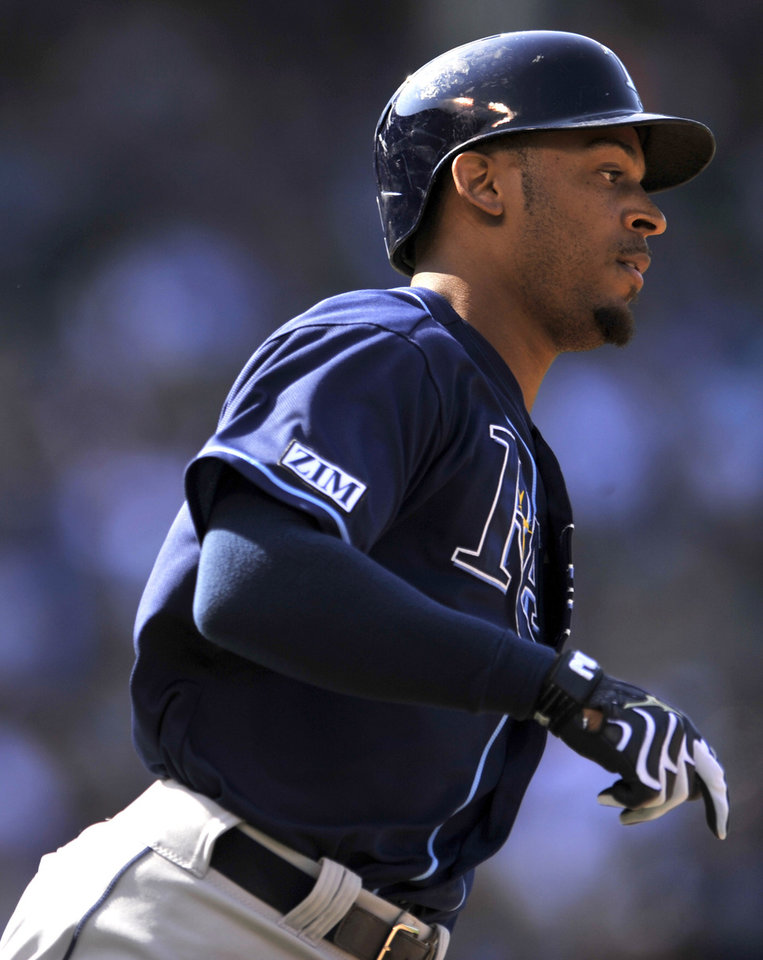 Photo - Tampa Bay Rays' Desmond Jennings watches his solo home run during the third inning of a baseball game against the Chicago Cubs in Chicago, Friday, Aug. 8, 2014. (AP Photo/Paul Beaty)