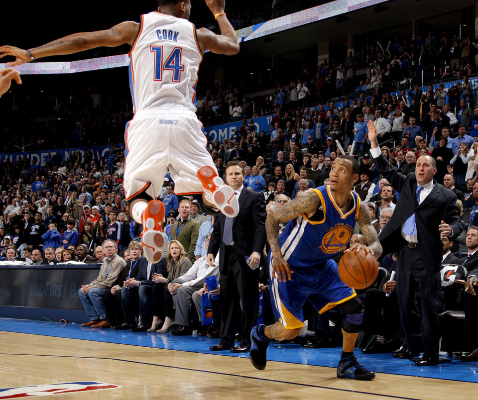 Oklahoma City\'s Daequan Cook (14) defends Golden State\'s Monta Ellis (8) as he looks up to make the game-tying basket during the NBA basketball game between the Oklahoma City Thunder and the Golden State Warriors at the Oklahoma City Arena, Tuesday, March 29, 2011. Photo by Bryan Terry, The Oklahoman