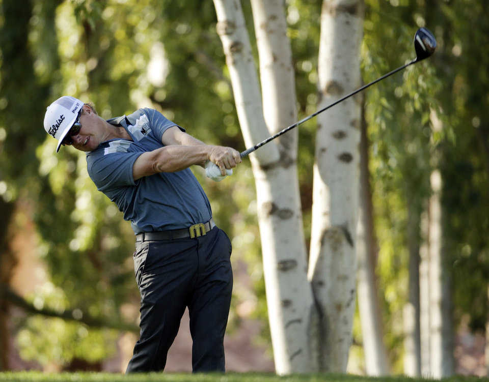 Photo - Charley Hoffman hits from the second tee during the third round of the Humana Challenge golf tournament on the Palmer Private course at PGA West Saturday, Jan. 18, 2014, in La Quinta, Calif. (AP Photo/Chris Carlson)