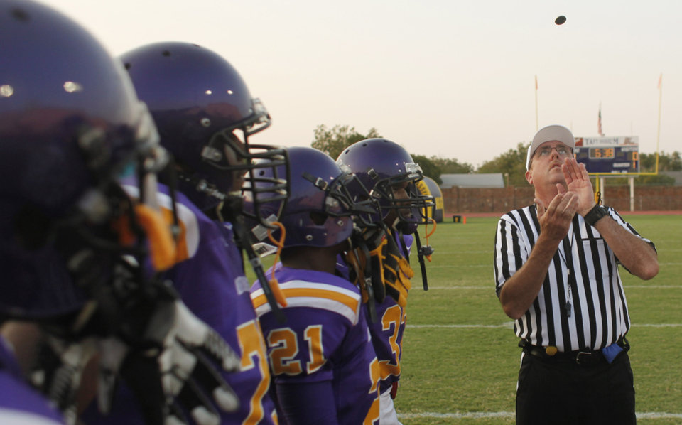 The coin toss at the Northwest Classen vs. Western Heights high school football game at Taft Stadium Thursday, September 20, 2012. Photo by Doug Hoke, The Oklahoman