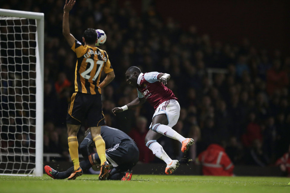 Photo - Hull City's goalkeeper Allan McGregor, bottom, brings down West Ham's Mohamed Diame, right, for a penalty and was red carded for the challenge during the English Premier League soccer match between West Ham and Hull City at Upton Park stadium in London, Wednesday, March 26, 2014. (AP Photo/Matt Dunham)