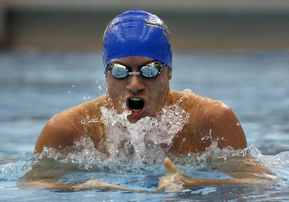East swimmer Chase Davis swims in the 200 yard IM, during the all-state swim meet, at the Jenks Trojan Aquatic Center, on Monday, July 29, 2013. CORY YOUNG/Tulsa World