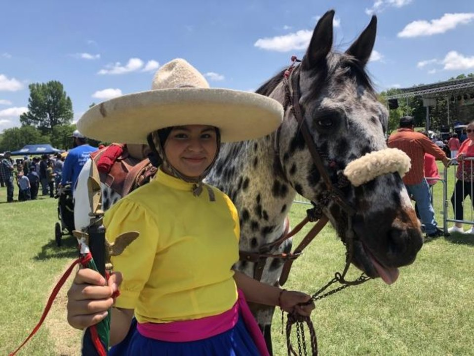 Photo -  Jessica Garcia, 12, of Bethany, and horse Becca performed side-saddle riding at the Cinco de Mayo festival Sunday at Wiley Post Park in south Oklahoma City. [ROBERT MEDLEY/THE OKLAHOMAN]