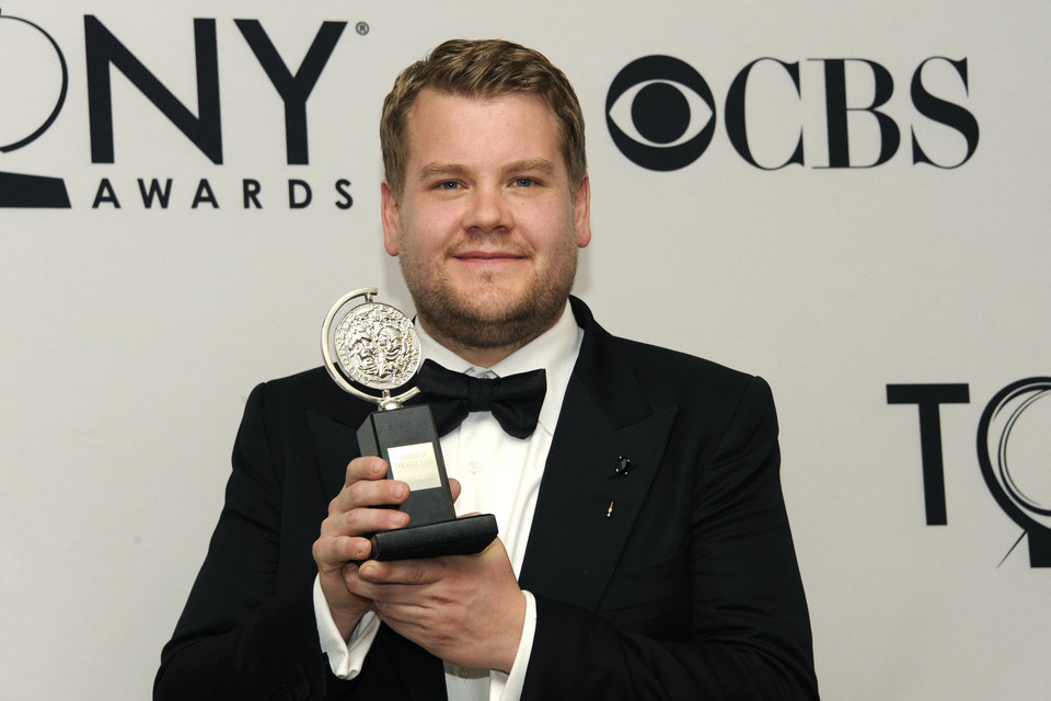 Photo -   James Corden holds his award for