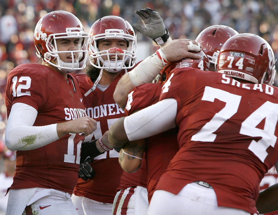 Photo - Oklahoma's Landry Jones (12) celebrates beside Trent Ratterree (47)after a touchdown during the college football game between the Texas A&M Aggies and the University of Oklahoma Sooners (OU) at Gaylord Family-Oklahoma Memorial Stadium on Saturday, Nov. 5, 2011, in Norman, Okla. Oklahoma won 41-25.  Photo by Bryan Terry, The Oklahoman