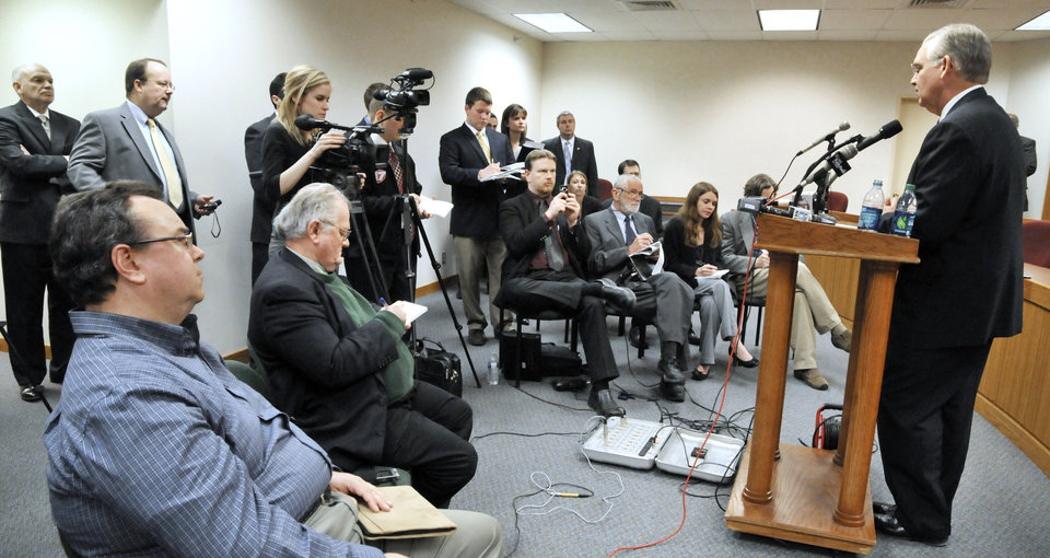 Photo - Gov. Jay Nixon has a brief press conference in Missouri's Capitol in Jefferson City, Wednesday, April 3, 2013, to answer questions regarding a meeting with legislators over  Medicaid funding.  (AP Photo/The Jefferson City News-Tribune, Julie Smith)
