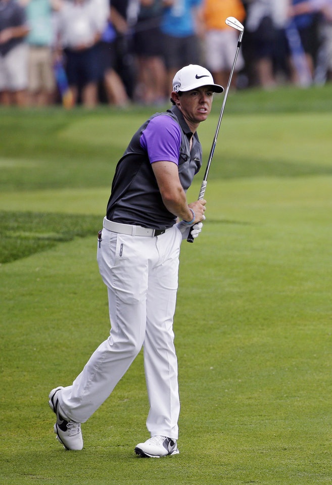 Photo - Rory McIlroy, of Northern Ireland, watches his shot from the fairway on the second hole during the final round of the PGA Championship golf tournament at Valhalla Golf Club on Sunday, Aug. 10, 2014, in Louisville, Ky. (AP Photo/John Locher)