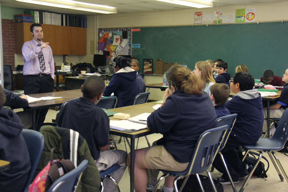 Photo - Sixth-grade science students listen to teacher Daniel Buckmaster, the Oklahoma City School District's Teacher of the Year, at Belle Isle Enterprise Middle School.    PROVIDED PHOTO BY COLIN STRICKLAND, THE FOUNDATION FOR OKLAHOMA CITY PUBLIC SCHOOLS