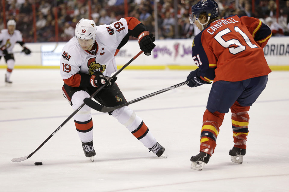 Photo - Ottawa Senators center Jason Spezza (19) skates against Florida Panthers defenseman Brian Campbell (51) during the first period of an NHL hockey game, Tuesday, March 25, 2014 in Sunrise, Fla. (AP Photo/Wilfredo Lee)