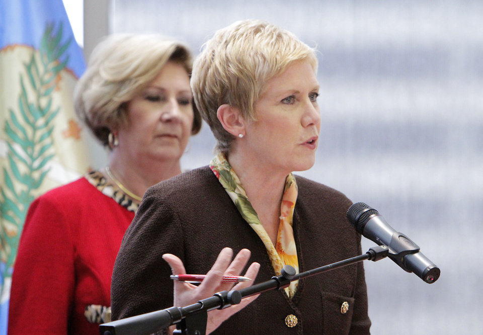 Photo - State Superintendent Janet Barresi speaks at a No Child Left Behind waiver press conference, Thursday, February 9, 2012.   In the background Secretary of Education Phyllis Hudecki.   Photo by David McDaniel, The Oklahoman