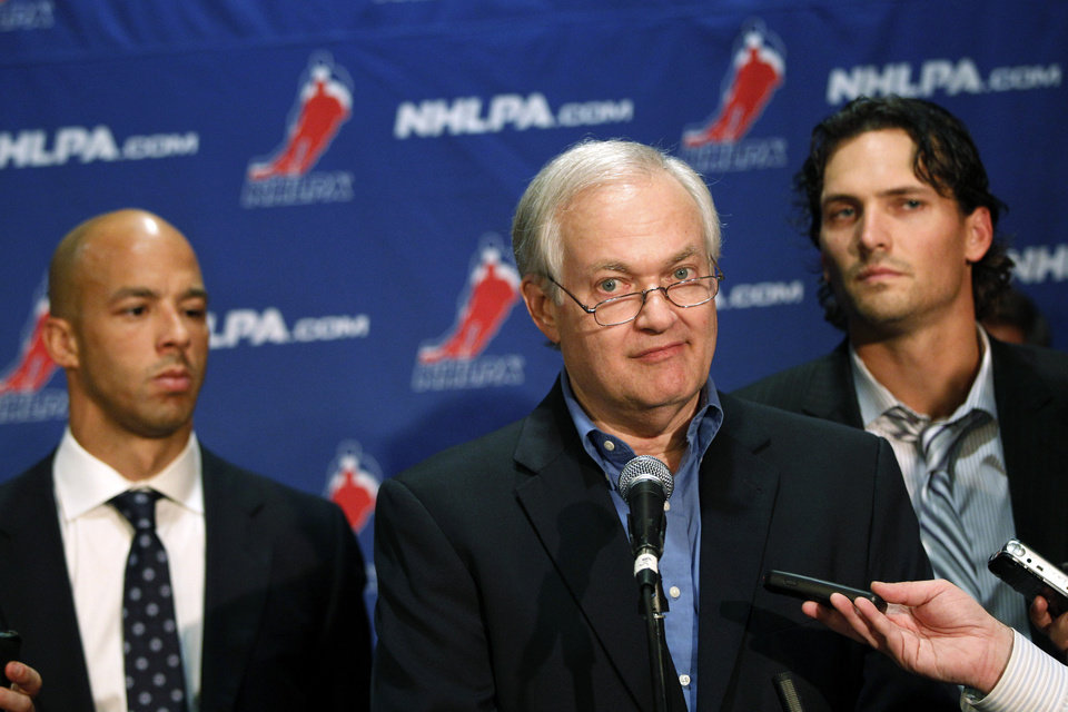Photo -   NHL Players' Association executive director Donald Fehr, center, is joined by Vancouver Canucks' Manny Malhotra, left, and Winnipeg Jets' Ron Hainsey as he speaks to reporters, Wednesday, Sept. 12, 2012, in New York. The NHL and the players' association swapped proposals Wednesday in an effort to head off a lockout scheduled to start this weekend. (AP Photo/Mary Altaffer)