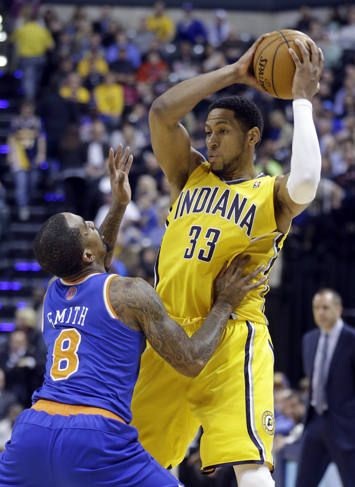 Photo - Indiana Pacers forward Danny Granger, right, looks to shoot over New York Knicks guard J.R. Smith during the second half of an NBA basketball game in Indianapolis, Thursday, Jan. 16, 2014. The Pacers defeated the Knicks 117-89. (AP Photo/Michael Conroy)