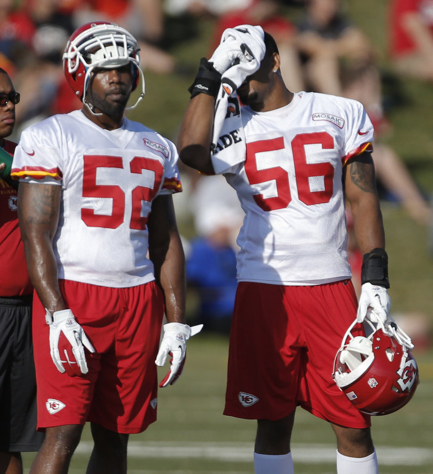 Kansas City Chiefs inside linebackers Derrick Johnson (56) and former Oklahoma State player Orie Lemon (52) cool off during NFL football training camp in St. Joseph, Mo., Saturday, July 27, 2013. (AP Photo/Orlin Wagner)