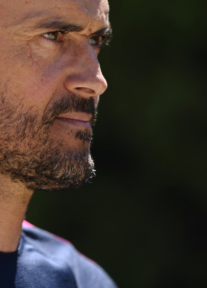 Photo - FC Barcelona's coach Luis Enrique arrives for a press conference at the Sports Center FC Barcelona Joan Gamper in San Joan Despi, Spain, Wednesday, July 16, 2014. Enrique takes charge of the squad on Tuesday when the team begins training for the 2014/15. (AP Photo/Manu Fernandez)