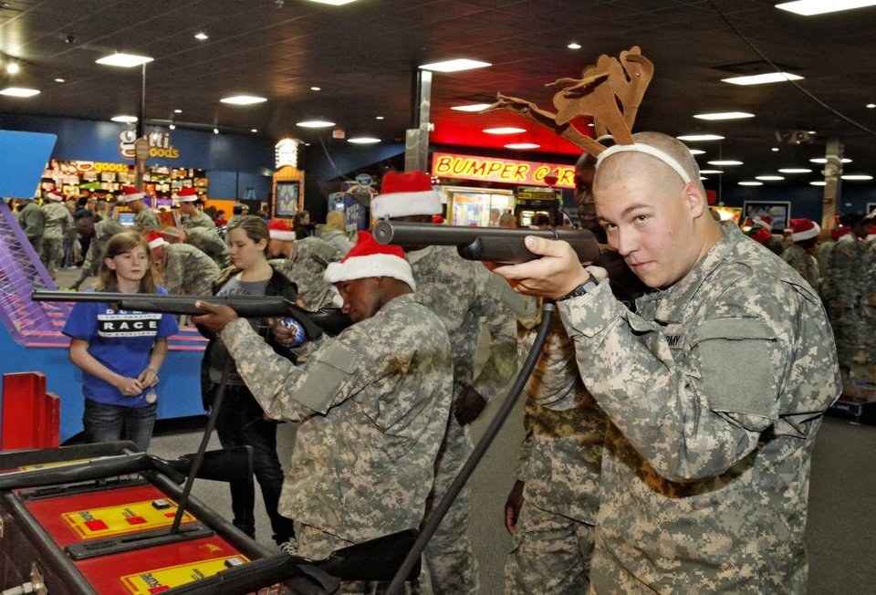 New recruit Pvt Daniel Hearn sports reindeer antlers while playing a shooting games during a lunch stop at Gatti Town during Soldiers Day Out, Friday, December 21, 2012. Edmond/North OKC Blue Star Mothers will be taking the soldiers who can't go home for Christmas around the metro for a day of fun. Photo By David McDaniel/The Oklahoman