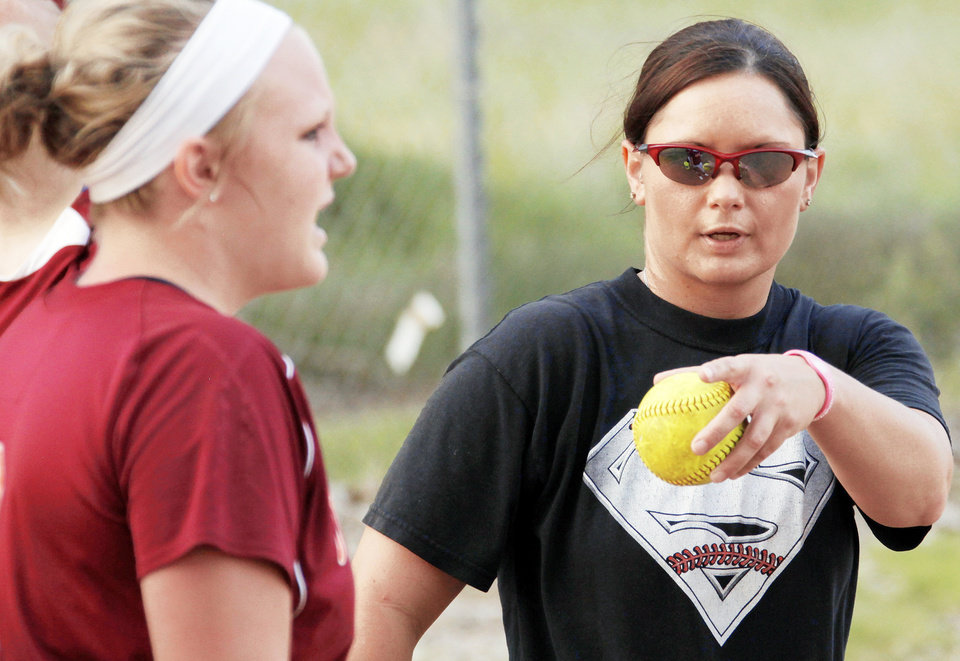 Photo - Mandy Fulton, coach of the OKC Strikkers, gives instructions near catcher Jayci Wehrenberg, left, during a practice earlier this month.  Fulton was a member of OU's 2000 national championship softball team.  Photo by Nate Billings, The Oklahoman
