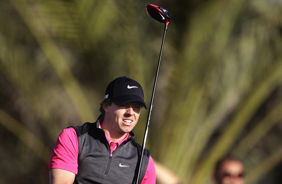 Rory McIlroy from Northern Ireland follows his ball on the 14th hole during the first round of Abu Dhabi Golf Championship in Abu Dhabi, United Arab Emirates, Thursday, Jan. 17, 2013. (AP Photo/Kamran Jebreili)