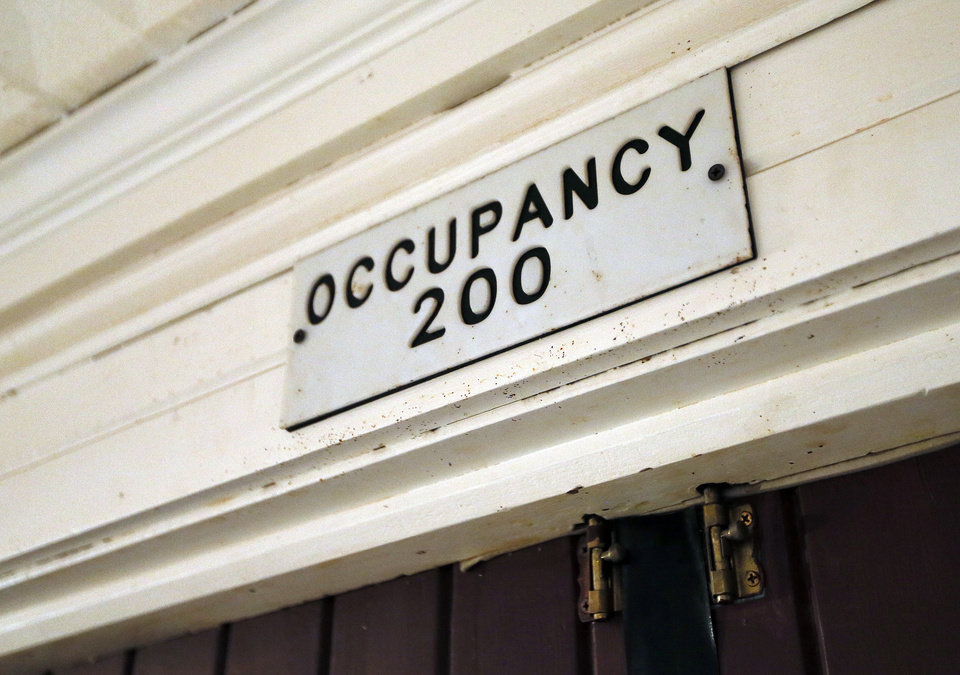 The occupant sign in the lobby at the Time Theater in Stigler, Okla., Thursday, Feb. 7, 2013. The community is raising the $100,000 needed to convert the theater to digital projection and keep it open. Photo by Nate Billings, The Oklahoman