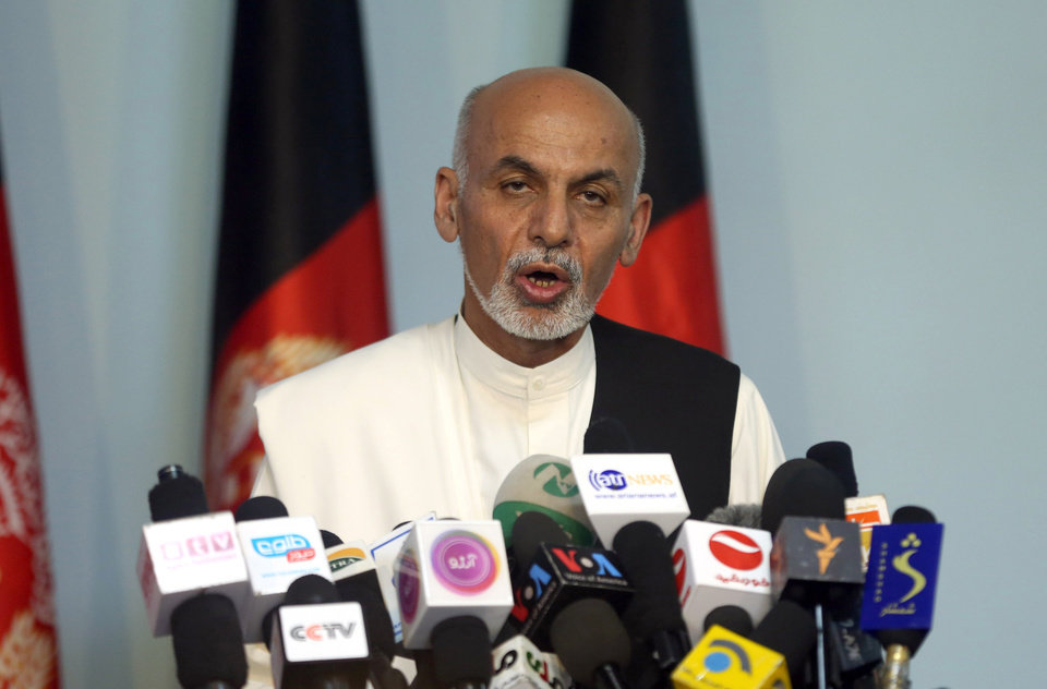 Photo - Afghan presidential candidate Ashraf Ghani Ahmadzai addresses a news conference in Kabul, Afghanistan, Tuesday, July 8, 2014. The Afghan Independent Election Commission released preliminary election results Monday showing former finance minister Ashraf Ghani Ahmadzai well in the lead for the presidency but said no winner could be declared because millions of ballots were being audited for fraud. (AP Photo/Massoud Hossaini)