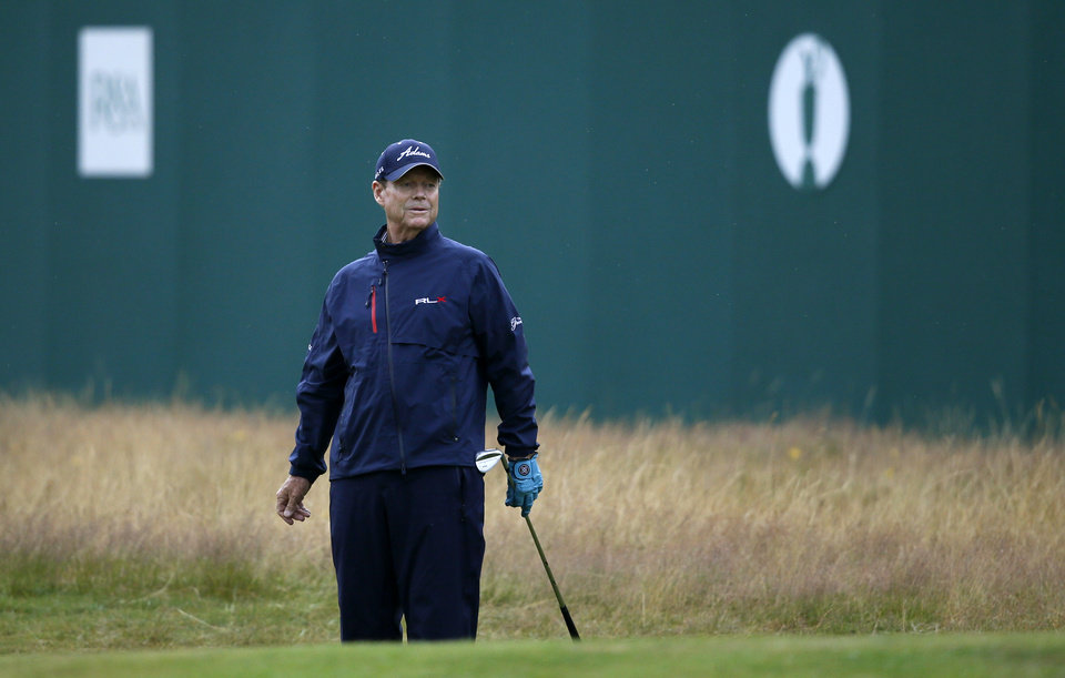Photo - Tom Watson of the US watches as his shot almost holes on the 18th green during the third day of the British Open Golf championship at the Royal Liverpool golf club, Hoylake, England, Saturday July 19, 2014. (AP Photo/Alastair Grant)