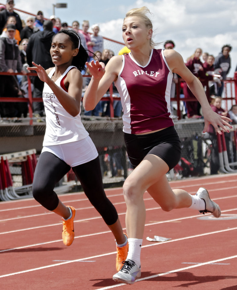 Northeast\'s Taylor Williams and Ripley\'s Shelby Akins race down the stretch in the Class 2A girls 100m dash during the Class A and 2A state championship track meet at Carl Albert High School on Friday, May 3, 2013, in Midwest City, Okla. Photo by Chris Landsberger, The Oklahoman