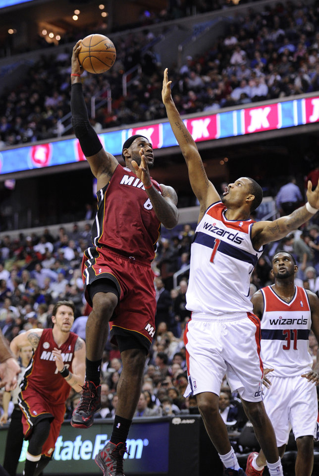 Miami Heat forward LeBron James (6) goes to the basket against Washington Wizards forward Trevor Ariza (1) during the first half of an NBA basketball game, Tuesday, Dec. 4, 2012, in Washington. (AP Photo/Nick Wass)