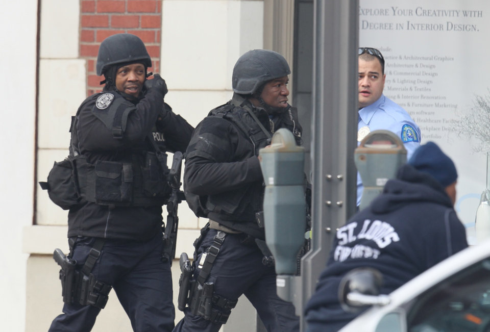 Photo - Police respond to the report of a shooting at Stevens Institute of Business and Arts in St. Louis on Tuesday, Jan. 15, 2013.  Police say a gunman entered the school and shot a person in the chest, then shot himself.  Everyone inside the building was evacuated, though police were checking the school to make sure the building was empty.  The conditions of the shooting victims were not immediately known.  (AP Photo/St. Louis Post-Dispatch, David Carson)