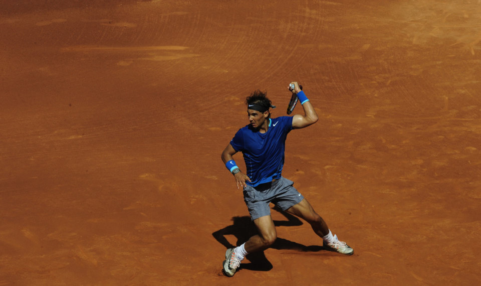 Photo - Rafael Nadal returns the ball to Albert Ramos during the Barcelona open tennis in Barcelona, Spain, Wednesday, April 23, 2014. (AP Photo/Manu Fernandez)