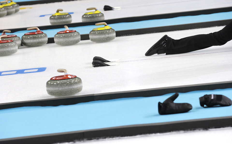 Photo - Denmark's Helle Simonsen slides off the hack as she delivers the rock during the first day of training at the 2014 Winter Olympics, Saturday, Feb. 8, 2014, in Sochi, Russia. (AP Photo/Wong Maye-E)