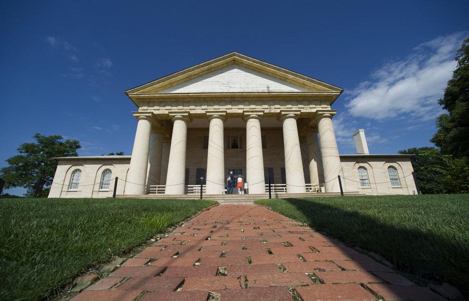 Photo - The historic Arlington House mansion is seen at Arlington National Cemetery in Arlington, Va., Thursday, July 17, 2014. The historic house and plantation originally built as a monument to George Washington overlooking the nation's capital that later was home to Confederate Gen. Robert E. Lee and 63 slaves will be restored to its historical appearance after a $12.3 million gift from Philanthropist David Rubenstein. (AP Photo/Cliff Owen)