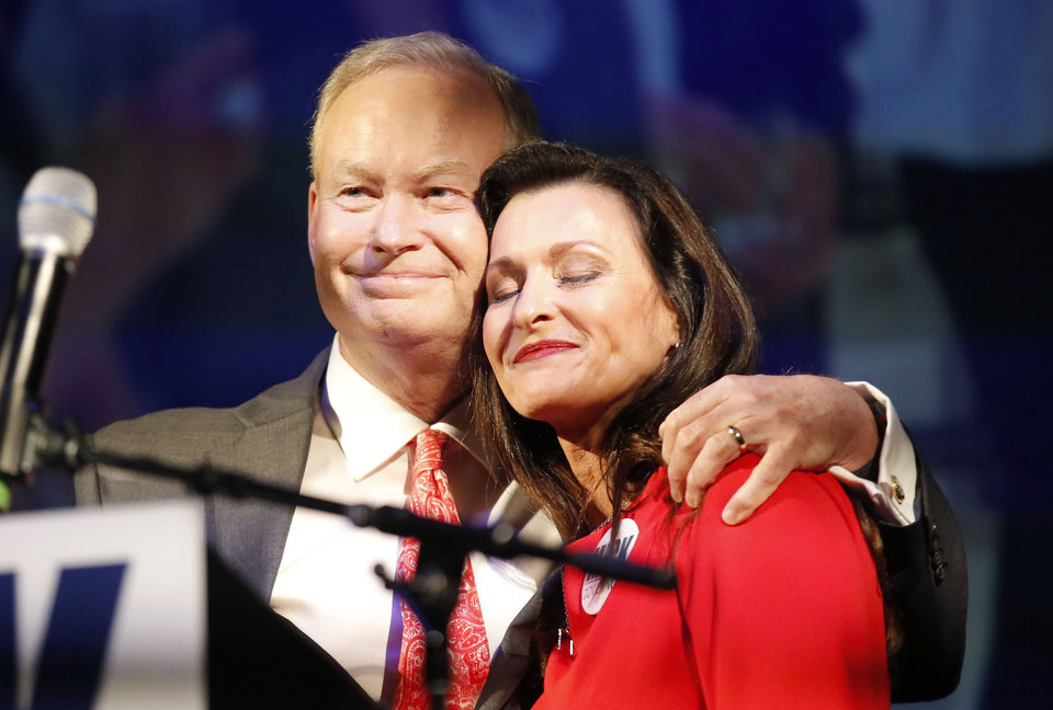 Photo - Mick Cornett and his wife Terri react after giving a concession speech during a watch party at the Tower Theatre in Oklahoma City , Tuesday, Aug. 28, 2018. Photo by Sarah Phipps, The Oklahoman