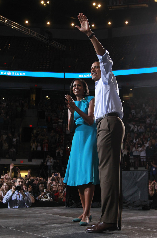 Photo -   President Barack Obama and first lady Michelle Obama wave to the crowd after speaking during a campaign rally at The Ohio State University, Saturday, May 5, 2012 in Columbus, Ohio . (AP Photo/Haraz N. Ghanbari)