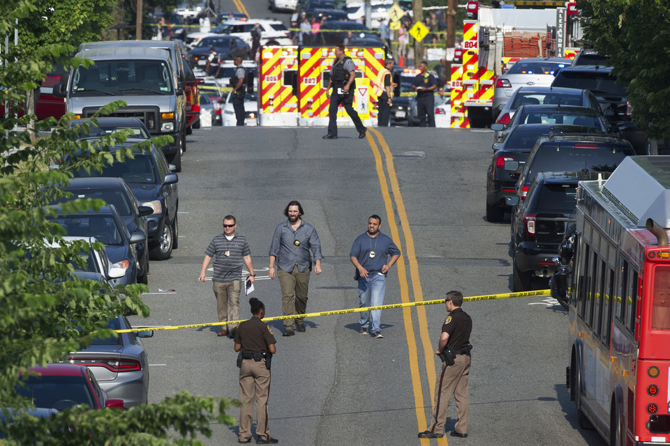 Photo - Police and emergency personnel are seen near the scene where House Majority Whip Steve Scalise of La. was shot during a Congressional baseball practice in Alexandria, Va., Wednesday, June 14, 2017.  (AP Photo/Cliff Owen)
