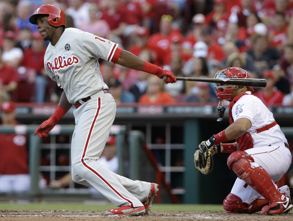 Photo - Philadelphia Phillies' John Mayberry Jr. gets a hit off Cincinnati Reds starting pitcher Johnny Cueto to drive in a run in the fourth inning of a baseball game, Friday, June 6, 2014, in Cincinnati. Brayan Pena catches at right. (AP Photo/Al Behrman)
