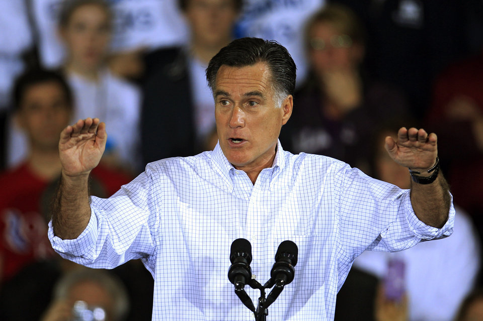 Photo -   Republican presidential candidate and former Massachusetts Gov. Mitt Romney speaks at a campaign event at Avon Lake High School Monday, Oct. 29, 2012, in Avon Lake, Ohio. (AP Photo/Tony Dejak)
