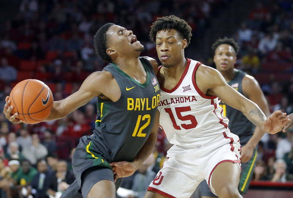 Photo - Oklahoma's Alondes Williams (15) defends Baylor's Jared Butler (12) during a men's NCAA basketball game between the University of Oklahoma Sooners (OU) and the Baylor Bears at the Lloyd Noble Center in Norman, Okla., Tuesday, Feb. 18, 2020. [Bryan Terry/The Oklahoman]