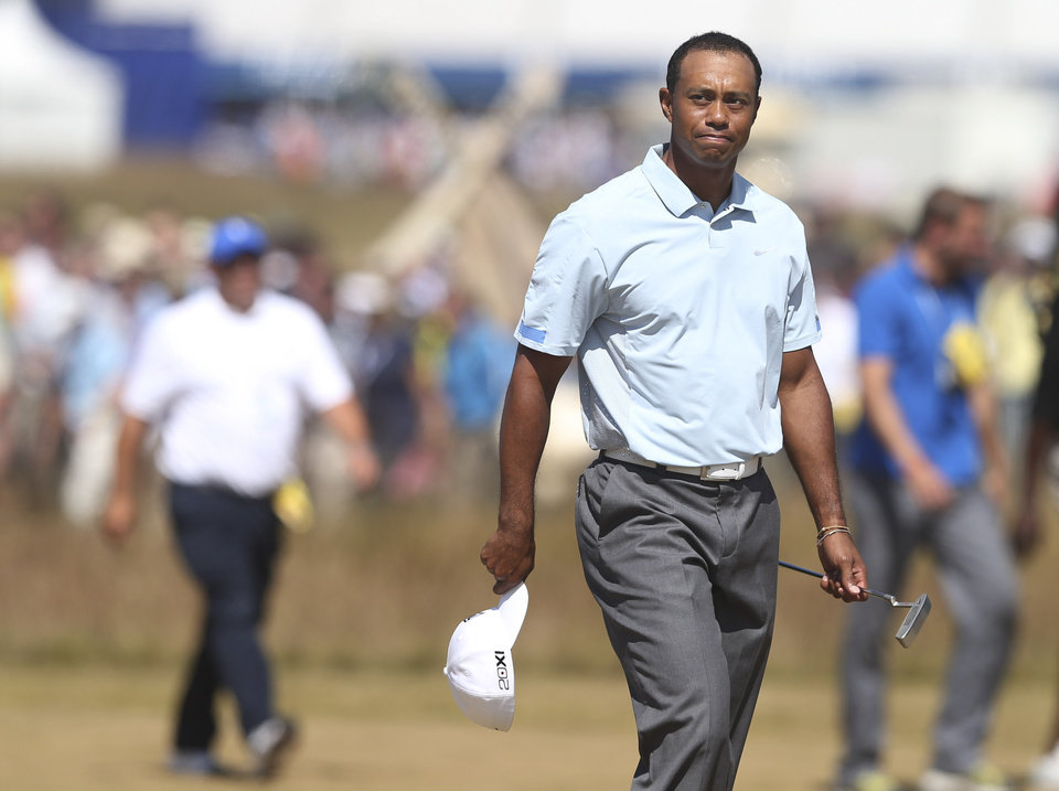 Photo - Tiger Woods of the United States walks onto the 18th green during the second round of the British Open Golf Championship at Muirfield, Scotland, Friday July 19, 2013. (AP Photo/Scott Heppell)