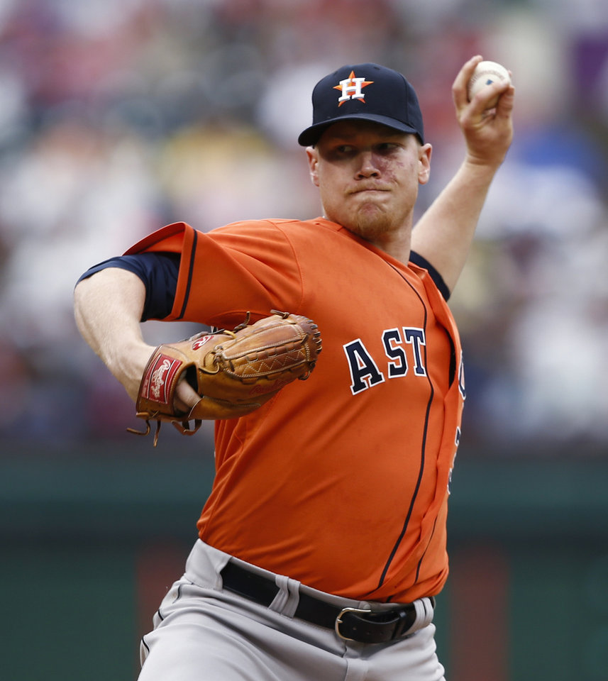 Photo - Houston Astros starting pitcher Brett Oberholtzer delivers a pitch to the Texas Rangers during the first inning of a baseball game, Sunday, April 13, 2014, in Arlington, Texas. (AP Photo/Jim Cowsert)