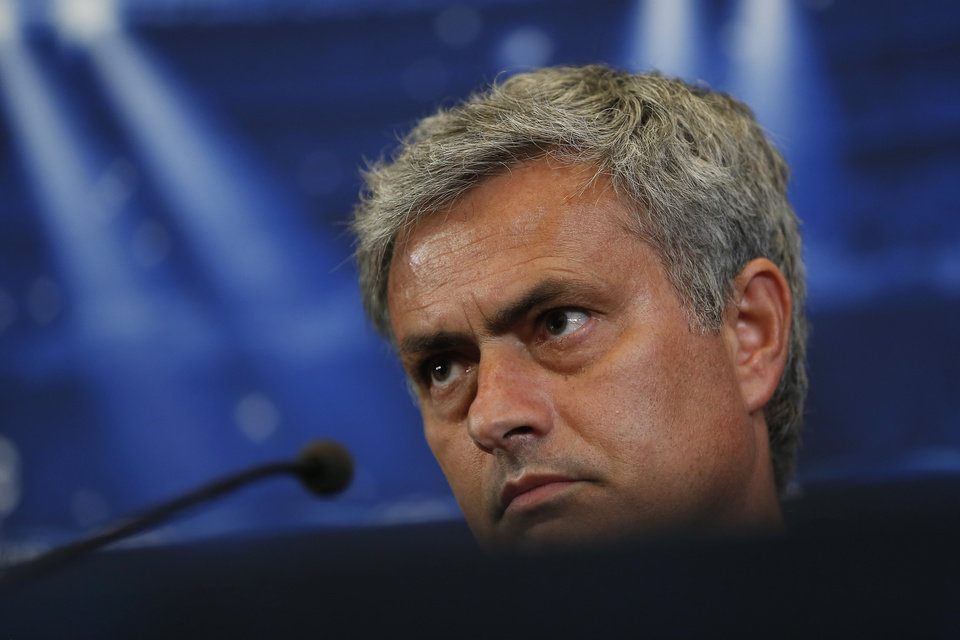 Photo - Chelsea's coach Jose Mourinho from Portugal listens to a question during a press conference ahead of Tuesday's Champions League, semifinal, first leg, soccer match against Atletico Madrid, at the Vicente Calderon stadium, in Madrid, Spain, Monday, April 21, 2014. (AP Photo/Andres Kudacki)