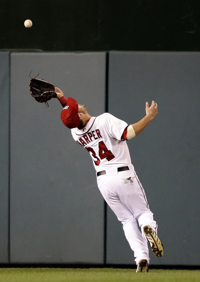 Photo -   Washington Nationals center fielder Bryce Harper catches a fly hit by Los Angeles Dodgers' Shane Victorino during the fifth inning of the second baseball game of a doubleheader at Nationals Park, Wednesday, Sept. 19, 2012, in Washington. The Dodgers won the second game 7-6. (AP Photo/Alex Brandon)