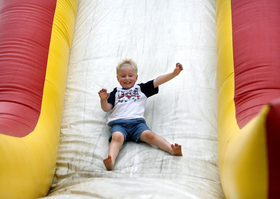 Benjamin Bewley, 3, slides down the inflatable gym course during Liberty Fest at UCO campus Saturday, July 4, 2009. Photo by Ashley McKee, The Oklahoman ORG XMIT: KOD