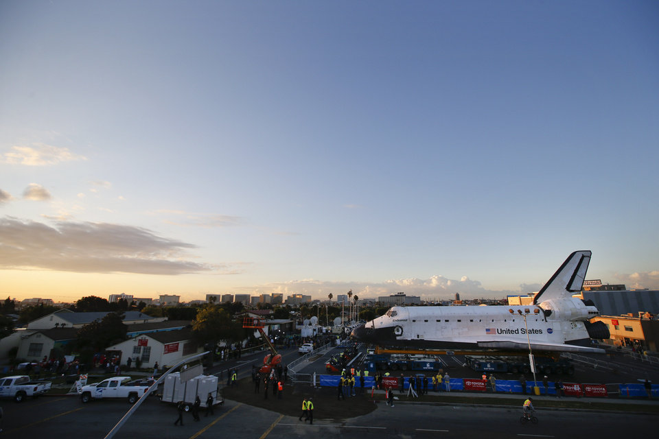 The space shuttle Endeavour sits in a strip mall near Los Angeles International Airport in Los Angeles, Friday, Oct. 12, 2012. Endeavour\'s 12-mile road trip kicked off shortly before midnight Thursday as it moved from its Los Angeles International Airport hangar en route to the California Science Center, its ultimate destination, said Benjamin Scheier of the center. (AP Photo/Jae C. Hong)