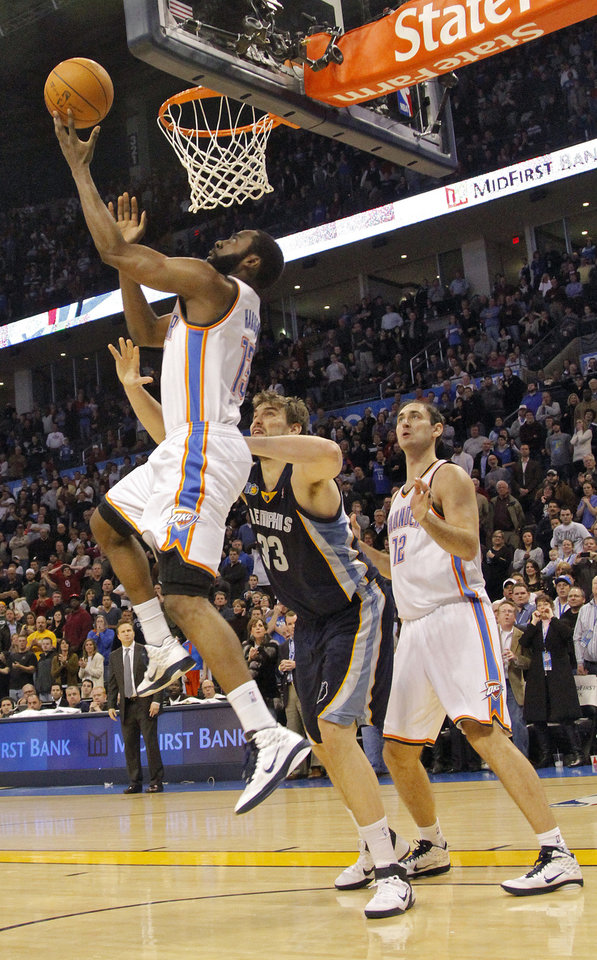 Photo - The Thunder's James Harden (13) misses the lay up at the end of regulation during the NBA basketball game between the Oklahoma City Thunder and the Memphis Grizzlies at the Oklahoma City Arena on Tuesday, Feb. 8, 2011, Oklahoma City, Okla.Photo by Chris Landsberger, The Oklahoman