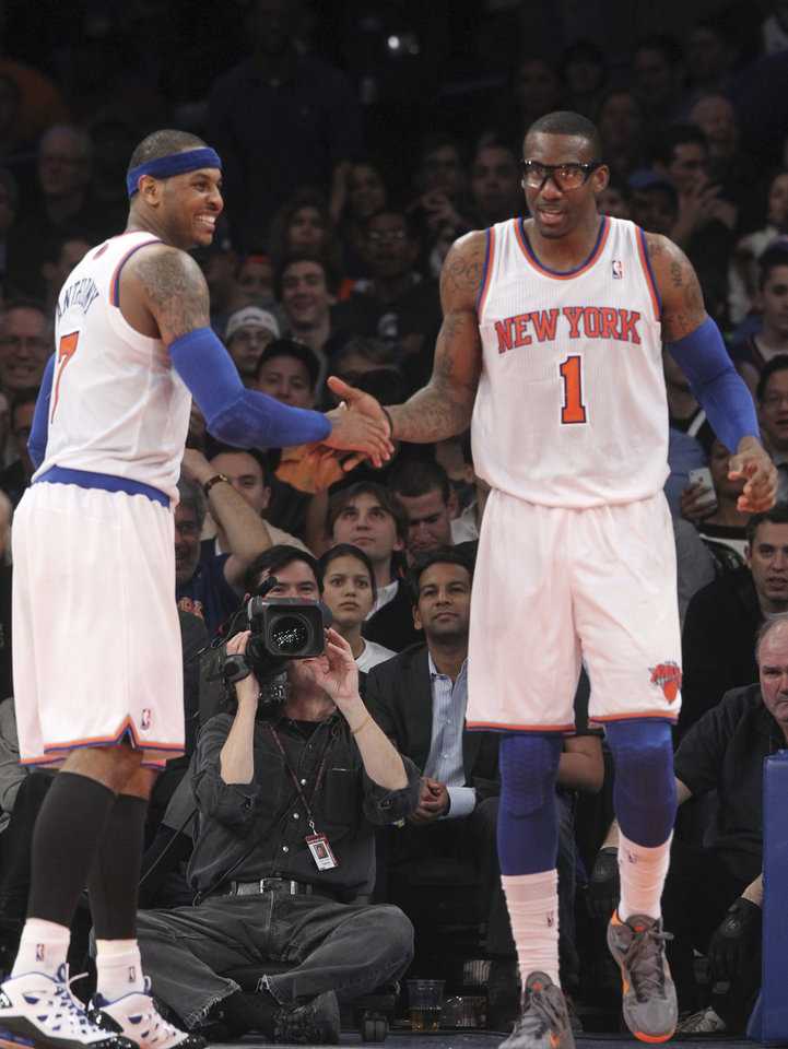 New York Knicks\' Carmelo Anthony, left, celebrates with Amare Stoudemire after Stoudemire scored during the second half of NBA basketball game against the Milwaukee Bucks, Friday, Feb. 1, 2013, at Madison Square Garden in New York. The Knicks won 96-86. (AP Photo/Mary Altaffer)