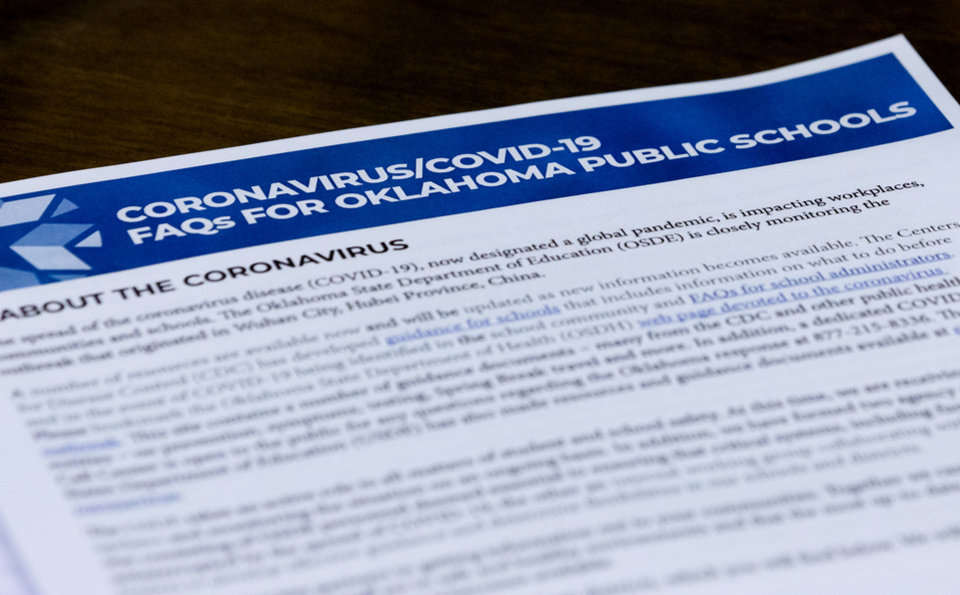 Photo - Paperwork presented to members of the State Board of Education during Oklahoma's State Superintendent of Public Instruction, Joy Hofmeister's emergency meeting of the Oklahoma State Department of Education in Oklahoma City, Okla. on Monday, March 16, 2020 to announce the closing of public school till April 6 to combat the spread of the Coronavirus.  [Chris Landsberger/The Oklahoman]