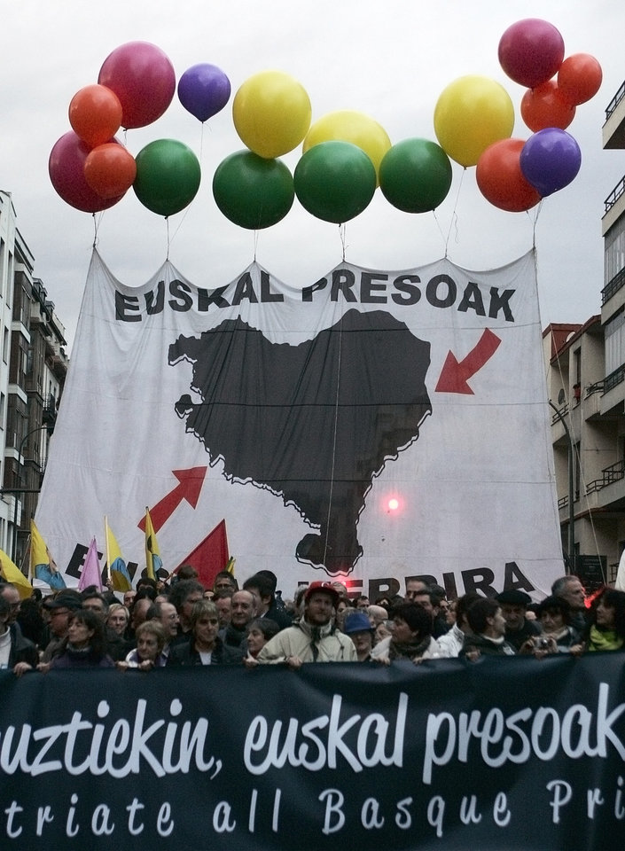 "Basque pro-independence supporters hold a banner reading ""Basque prisoners"" as they march calling for an amnesty that would allow ETA prisoners to serve out the remainder of their sentences in this northern region rather than in jails further afield, during a rally in Bilbao northern Spain, Saturday, Jan. 12, 2013.  Spain has for more than two decades dispersed ETA prisoners under an amendment to the country's 1975 anti-terrorism law. There are an estimated 700 ETA prisoners held in jails dotted around Spain and France and only around two dozen believed to be in Basque region goals. (AP Photo/Gaizka Bilbao)"