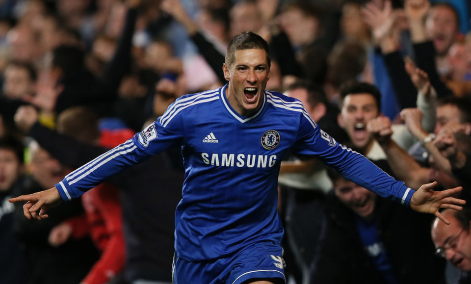 "Photo - FILE - In this Sunday, Oct. 27, 2013, file photo, Chelsea's Fernando Torres celebrates after scoring the winning goal during the English Premier League soccer match between Chelsea and Manchester City. Chelsea says it has agreed terms with AC Milan for striker Fernando Torres to join the Serie A club in a two-year loan deal. The Premier League club said in a statement that ""the move is now subject to Fernando agreeing personal terms with AC Milan and passing a medical examination."" The deal was announced a few hours after Chelsea manager Jose Mourinho had raised the prospect of Torres leaving before the transfer window closes, saying the Spain striker may be ready to ""try a new life, a new club, probably a new league."" Torres joined Chelsea from Liverpool in January 2011 for what was then a British-record fee of 50 million pounds (then $81 million), but has struggled to command a regular starting place for the London club. (AP Photo/Alastair Grant, File)"