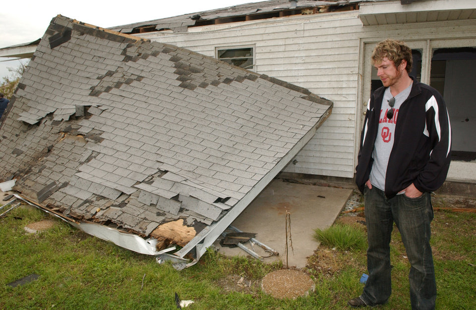 Photo - TORNADO DAMAGE, HOUSE: Joe Don Rooney, with the country music group Rascal Flatts outside of his boyhood home in Picher, Okla. which was destroyed in the tornado Saturday evening.   BY GARY CROW, FOR THE OKLAHOMAN ORG XMIT: KOD