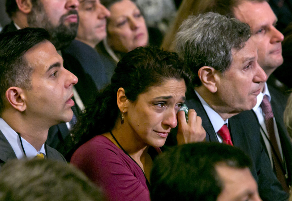 Photo - A woman in the audience dries a tear during the dedication ceremony in Foundation Hall, of the National September 11 Memorial Museum, in New York, Thursday, May 15, 2014. (AP Photo/Richard Drew, Pool)