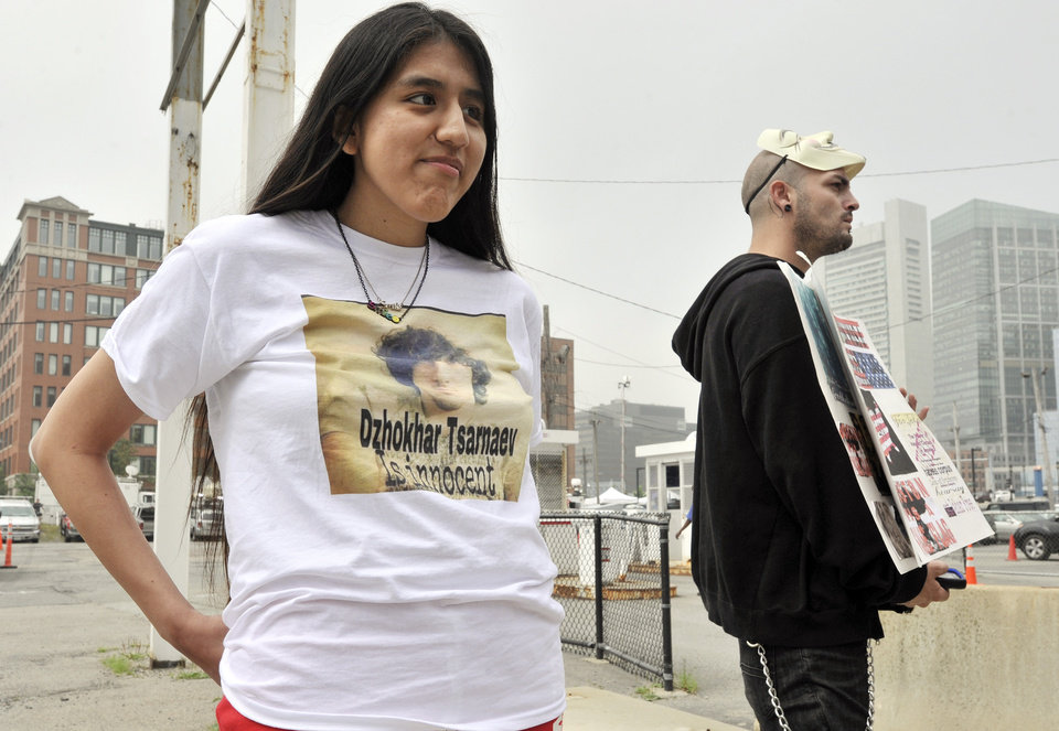 Photo - Jennifer Michio, left, from Mashantucket, Conn., and Duke La Touf, right, of Las Vegas, stand in support of Boston Marathon bombing suspect Dzhokhar Tsarnaev outside the federal courthouse prior to his arraignment Wednesday, July 10, 2013, in Boston. The April 15 attack killed three and wounded more than 260. The 19-year-old Tsarnaev has been charged with using a weapon of mass destruction, and could face the death penalty. (AP Photo/Josh Reynolds)